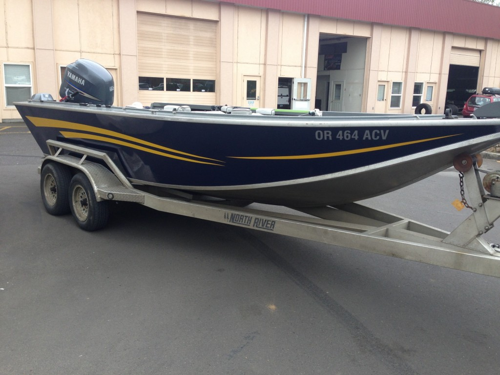 Blue and Yellow Custom Boat Wrap by Coho Design
