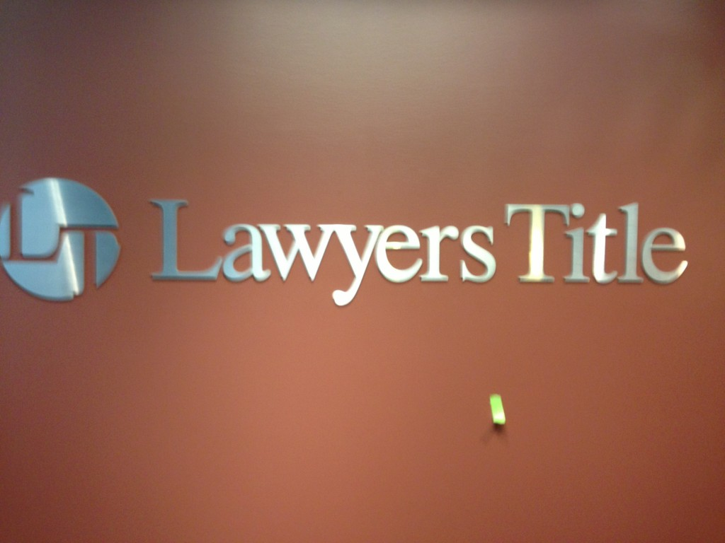 Lawyers Title signature by Coho Design